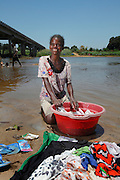 Lady washing her clothes in river. Near Mahanaro Madagascar. November 2015. Photo - Zute Lightfoot