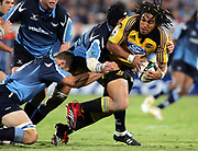 Hurricanes centre Ma'a Nonu looks for support during the Super 14 rugby union match between the Bulls and Hurricanes at Loftus Pretoria, South Africa, on Friday 17 March, 2006. The Hurricanes won the match 26-23. Photo: Africa Visuals/PHOTOSPORT **NZ USE ONLY**<br /> <br /> <br /> 149904