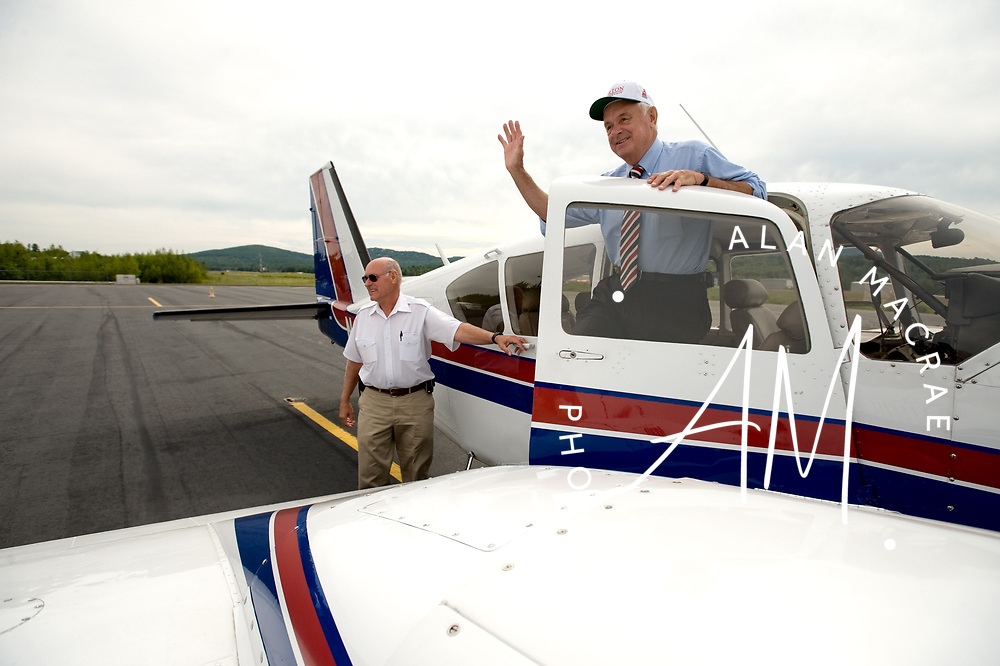 Executive Councilor Ray Burton, right, boards a Piper Aztec twin engine aircraft at the Laconia Airport on his annual airport tour on Wednesday, August 18, 2010.  On the left is pilot Harvey Sawyer.  (Alan MacRae/for the Citizen)
