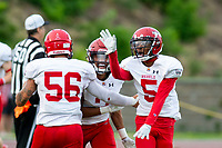 KELOWNA, BC - AUGUST 17:  Jesse Zajaros #56, Maleek Womack #5 and Colby Henkel #2 of Westshore Rebels celebrate a touchdown against the Okanagan Sun  at the Apple Bowl on August 17, 2019 in Kelowna, Canada. (Photo by Marissa Baecker/Shoot the Breeze)