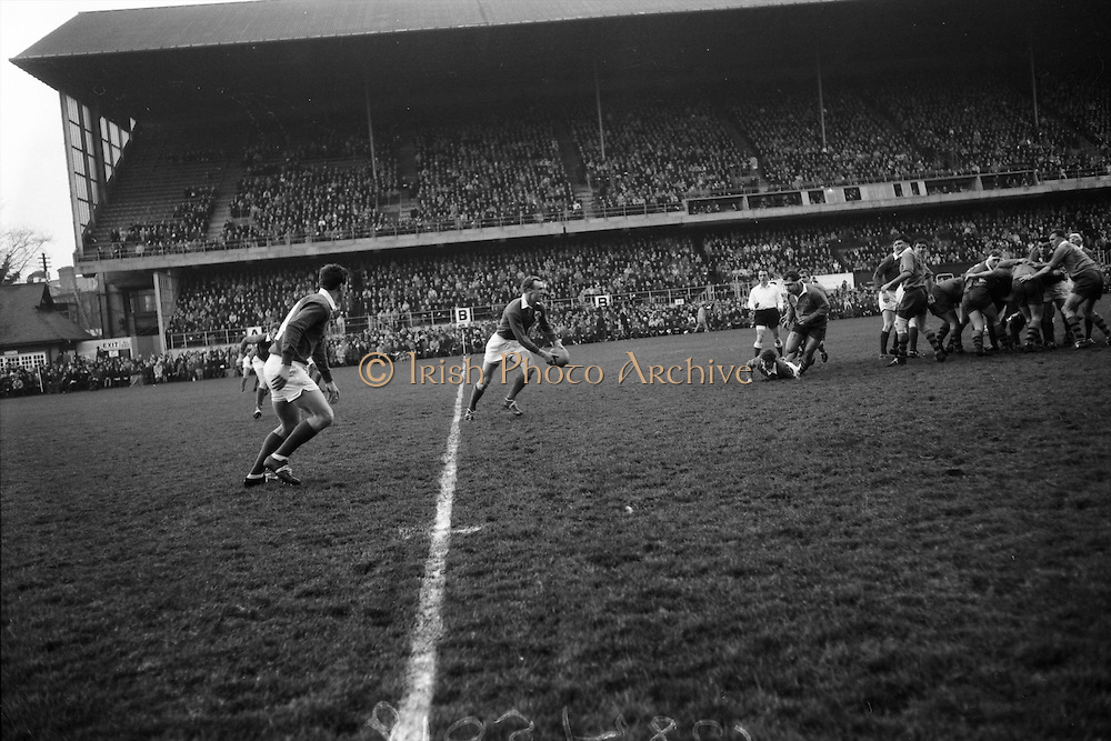 A pass from Sherry finds Gibson unmarked, as he decides where to kick ahead,..Irish Rugby Football Union, Ireland v Australia, Tour Match, Landsdowne Road, Dublin, Ireland, Saturday 21st January, 1967,.21.1.1967, 1.21.1967,..Referee- M Joseph, Welsh Rugby Union, ..Score- Ireland 15 - 8 Australia, ..Irish Team, ..T J Kiernan,  Wearing number 15 Irish jersey, Full Back, Cork Constitution Rugby Football Club, Cork, Ireland,..A T A Duggan, Wearing number 14 Irish jersey, Right Wing, Landsdowne Rugby Football Club, Dublin, Ireland,..F P K Bresnihan, Wearing number 13 Irish jersey, Right Centre, University College Dublin Rugby Football Club, Dublin, Ireland, ..H H Rea, Wearing number 12 Irish jersey, Left Centre, Edinburgh University Rugby Football Club, Edinburgh, Scotland, ..P J McGrath,  Wearing number 11 Irish jersey, Left Wing, University college Cork Rugby Football Club, Cork, Ireland,  ..C M H Gibson, Wearing number 10 Irish jersey, Stand Off, N.I.F.C, Rugby Football Club, Belfast, Northern Ireland, ..B F Sherry, Wearing number 9 Irish jersey, Scrum Half, Terenure Rugby Football Club, Dublin, Ireland, ..K G Goodall, Wearing number 8 Irish jersey, Forward, Newcastle University Rugby Football Club, Newcastle, England, ..M G Doyle, Wearing number 7 Irish jersey, Forward, Edinburgh Wanderers Rugby Football Club, Edinburgh, Scotland, ..N Murphy, Wearing number 6 Irish jersey, Forward, Cork Constitution Rugby Football Club, Cork, Ireland,..M Molloy, Wearing number 5 Irish jersey, Forward, University College Galway Rugby Football Club, Galway, Ireland,  ..W J McBride, Wearing number 4 Irish jersey, Forward, Ballymena Rugby Football Club, Antrim, Northern Ireland,..P O'Callaghan, Wearing number 3 Irish jersey, Forward, Dolphin Rugby Football Club, Cork, Ireland, ..K W Kennedy, Wearing number 2 Irish jersey, Forward, C I Y M S Rugby Football Club, Belfast, Northern Ireland, ..T A Moroney, Wearing number 1 Irish jersey, Forward, University College Dublin Rugby Football Club,