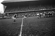 A pass from Sherry finds Gibson unmarked, as he decides where to kick ahead,..Irish Rugby Football Union, Ireland v Australia, Tour Match, Landsdowne Road, Dublin, Ireland, Saturday 21st January, 1967,.21.1.1967, 1.21.1967,..Referee- M Joseph, Welsh Rugby Union, ..Score- Ireland 15 - 8 Australia, ..Irish Team, ..T J Kiernan,  Wearing number 15 Irish jersey, Full Back, Cork Constitution Rugby Football Club, Cork, Ireland,..A T A Duggan, Wearing number 14 Irish jersey, Right Wing, Landsdowne Rugby Football Club, Dublin, Ireland,..F P K Bresnihan, Wearing number 13 Irish jersey, Right Centre, University College Dublin Rugby Football Club, Dublin, Ireland, ..H H Rea, Wearing number 12 Irish jersey, Left Centre, Edinburgh University Rugby Football Club, Edinburgh, Scotland, ..P J McGrath,  Wearing number 11 Irish jersey, Left Wing, University college Cork Rugby Football Club, Cork, Ireland,  ..C M H Gibson, Wearing number 10 Irish jersey, Stand Off, N.I.F.C, Rugby Football Club, Belfast, Northern Ireland, ..B F Sherry, Wearing number 9 Irish jersey, Scrum Half, Terenure Rugby Football Club, Dublin, Ireland, ..K G Goodall, Wearing number 8 Irish jersey, Forward, Newcastle University Rugby Football Club, Newcastle, England, ..M G Doyle, Wearing number 7 Irish jersey, Forward, Edinburgh Wanderers Rugby Football Club, Edinburgh, Scotland, ..N Murphy, Wearing number 6 Irish jersey, Forward, Cork Constitution Rugby Football Club, Cork, Ireland,..M Molloy, Wearing number 5 Irish jersey, Forward, University College Galway Rugby Football Club, Galway, Ireland,  ..W J McBride, Wearing number 4 Irish jersey, Forward, Ballymena Rugby Football Club, Antrim, Northern Ireland,..P O'Callaghan, Wearing number 3 Irish jersey, Forward, Dolphin Rugby Football Club, Cork, Ireland, ..K W Kennedy, Wearing number 2 Irish jersey, Forward, C I Y M S Rugby Football Club, Belfast, Northern Ireland, ..T A Moroney, Wearing number 1 Irish jersey, Forward, University College Dublin Rugby Football Club,