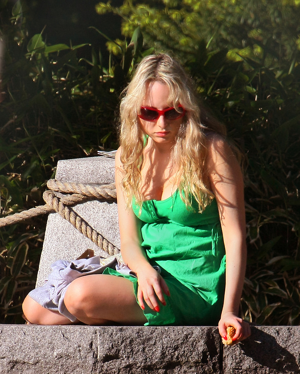 Woman in a green dress.