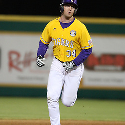 2009 February 20: LSU's Blake Dean rounds second base after hitting a homerun during a NCAA baseball match up between the #1 ranked LSU Tiger and the unranked Villanova Wilcats at the newly constructed Alex Box Stadium in Baton Rouge, Louisiana..