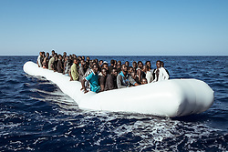 September 11, 2016 - Mediterranean Sea, Border Libya and Italy, Italy - A rubber boat in distress with 120 people on board is found approximately 23 miles north-east of Tripoli (Libya) on September 11th 2016. Reportage from the rescue vessel Aquarius, operated by the NGOs SOS Méditerranée and Médicins Sans Frontières (MSF), which conducts migrants search and rescue operations in the Mediterranean sea. Since the beginning of its mission, in February 2016, to October of the same year, the Aquarius team rescued more than 6,000 people. (Credit Image: © Marco Panzetti/NurPhoto via ZUMA Press)