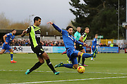 AFC Wimbledon midfielder Chris Whelpdale (11) attempts to block Bury FC midfielder Jacob Mellis (18) clearance during the EFL Sky Bet League 1 match between AFC Wimbledon and Bury at the Cherry Red Records Stadium, Kingston, England on 19 November 2016. Photo by Stuart Butcher.