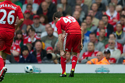 LIVERPOOL, ENGLAND - Saturday, April 23, 2011: Liverpool's Jack Robinson pulls up injured during the Premiership match against Birmingham City at Anfield. (Photo by David Rawcliffe/Propaganda)