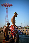 A kid ready to jump from the Coney Island pier in Brooklyn, New York, 2010.