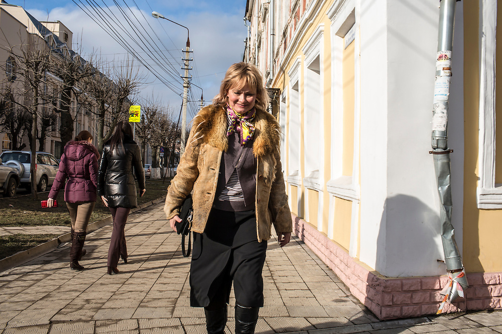 Inessa Rozova, Alexander Panin's mother, walks down the street on Tuesday, February 25, 2014 in Tver, Russia. Panin, a Russian citizen who was arrested in the Dominican Republic in June 2013, is set to be charged by federal authorities in the US with being part of a gang which robbed bank accounts via the Internet. Photo by Brendan Hoffman, Freelance