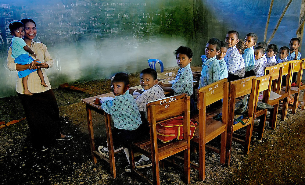 School children attend class in their half built classroom on Lembata Island, Indonesia.