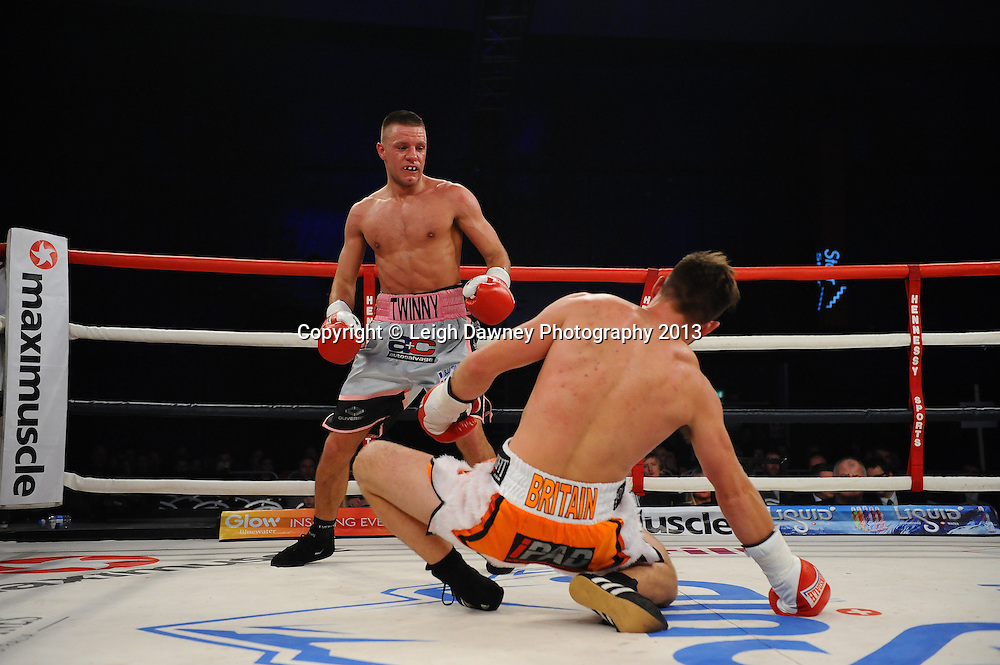 Chris Jenkinson knocks down Adam Battle during their  Light Middleweight contest. Glow, Bluewater, Kent, UK. Hennessy Sports © Leigh Dawney Photography 2013.