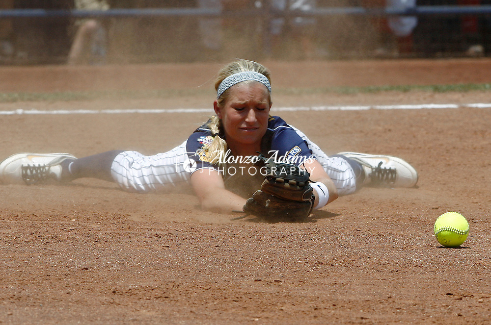California's Jace Williams misses an infield hit by Alabama during the NCAA Division I Women's Softball Championship held at the ASA Hall of Fame Stadium in Oklahoma City, Thursday, June 2, 2011.  (AP Photo/Alonzo Adams)