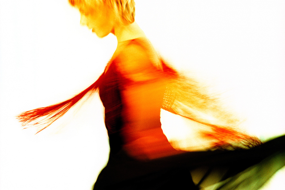 Dancer sways by in red