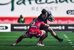 Dragons' Sam Beard is tackled by Scarlets' Steffan Hughes<br /> <br /> Photographer Craig Thomas/Replay Images<br /> <br /> Guinness PRO14 Round 13 - Scarlets v Dragons - Friday 5th January 2018 - Parc Y Scarlets - Llanelli<br /> <br /> World Copyright © Replay Images . All rights reserved. info@replayimages.co.uk - http://replayimages.co.uk