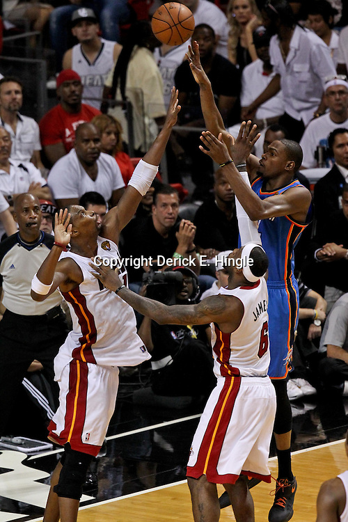 Jun 21, 2012; Miami, FL, USA; Oklahoma City Thunder small forward Kevin Durant (35) shoots over Miami Heat power forward Chris Bosh (1) and small forward LeBron James (6) during the second quarter in game five in the 2012 NBA Finals at the American Airlines Arena. Mandatory Credit: Derick E. Hingle-US PRESSWIRE