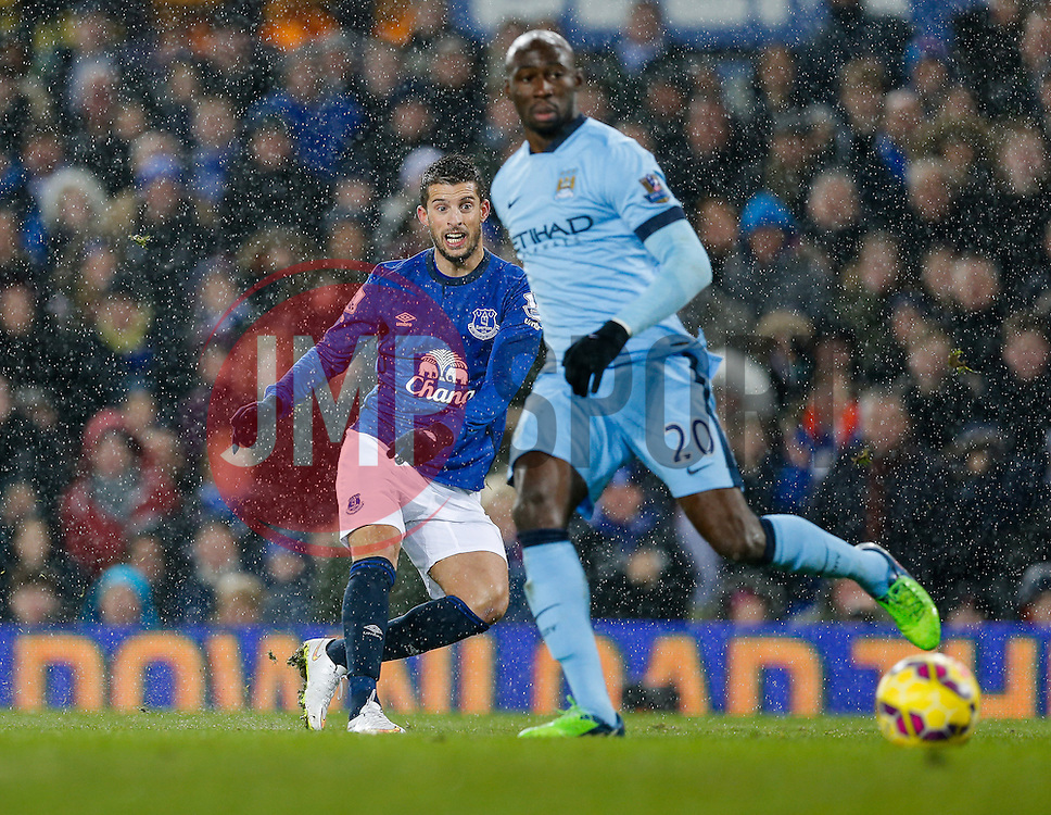 Kevin Mirallas of Everton shoots past Eliaquim Mangala of Manchester City - Photo mandatory by-line: Rogan Thomson/JMP - 07966 386802 - 10/01/2015 - SPORT - FOOTBALL - Liverpool, England - Goodison Park - Everton v Manchester City - Barclays Premier League.