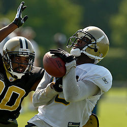 July 31, 2010; Metairie, LA, USA; New Orleans Saints wide receiver Courtney Roby (15) loses his grip on a pass as cornerback Randall Gay (20) defends during a training camp practice at the New Orleans Saints practice facility. Mandatory Credit: Derick E. Hingle