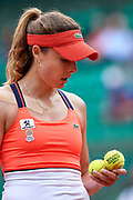 Paris, France - 2017 June 03: Alize Cornet from France  looks at the balls during women's single match third round  during tennis Grand Slam tournament The French Open 2017 (also called Roland Garros) at Stade Roland Garros on June 03, 2017 in Paris, France.<br /> <br /> Mandatory credit:<br /> Photo by &copy; Adam Nurkiewicz<br /> <br /> Adam Nurkiewicz declares that he has no rights to the image of people at the photographs of his authorship.<br /> <br /> Picture also available in RAW (NEF) or TIFF format on special request.<br /> <br /> Any editorial, commercial or promotional use requires written permission from the author of image.