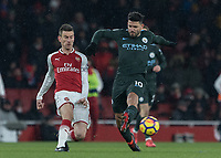 Football - 2017 / 2018 Premier League - Arsenal vs. Manchester City<br /> <br /> Sergio Aguero (Manchester City) tries to get to the ball before Laurent Koscielny (Arsenal FC) at The Emirates.<br /> <br /> COLORSPORT/DANIEL BEARHAM