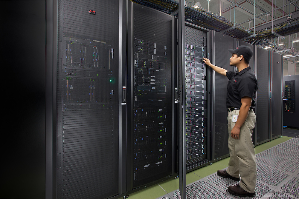 Interior image of man monitoring the equipment in the Main Server Room at DC6 in Manassas