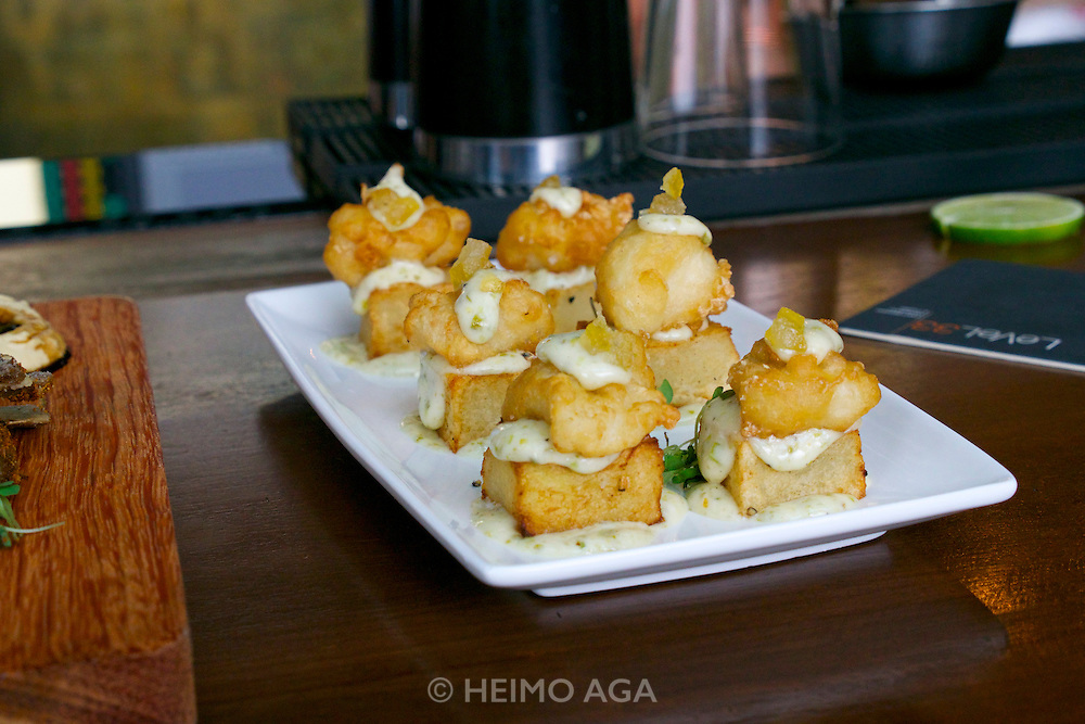 "Singapore. Level 33 Restaurant & Lounge offers ""experimental penthouse dining in the World's highest urban craft-brewery.""<br /> Fish & chips: Tempura of black cod with fat cut potato, sauce tartare and candied lemon"