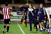 AFC Wimbledon manager Neal Ardley pointing during the EFL Cup match between AFC Wimbledon and Brentford at the Cherry Red Records Stadium, Kingston, England on 8 August 2017. Photo by Matthew Redman.