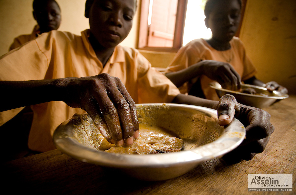 Soale Ibrahim, 16, enjoys his lunch in a classroom at the Nyologu Primary School in the village of Nyologu, northern Ghana, on Wednesday June 6, 2007.
