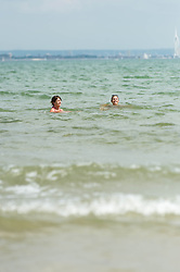© Licensed to London News Pictures. 14/06/2014. Ryde, Isle of Wight, UK. People swim in the sea on a hot sunny morning.  The UK is experiencing a period of hot sunny weather with temperatures over the weekend expected to reach 74 F (23 C).  Photo credit : Richard Isaac/LNP