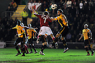 Wrexham's Adrian Cieslewicz (7) battles for the ball with Newport's Andy Sandell (13). Blue Square Bet Premier division, Newport County FC v Wrexham at Rodney Parade in Newport, South Wales on Friday 4th Jan 2013. pic by Andrew Orchard, Andrew Orchard sports photography,