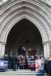 Royal Courts of Justice, London, February 8th 2017. As day two for the appeal hearing for 'Marine A' - Sgt Alex Blackman draws to a close, retired Marines and supporters gather on the steps of the High Court as his wife Claire emerges from the building. PICTURED: Marine veterans on the steps of the High Court.