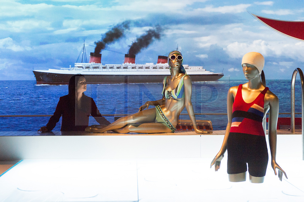 © Licensed to London News Pictures. 31/01/2018. London, UK.  A museum staff member views a recreation of a swimming pool with swimming costumes on display as part of the Ocean Liners: Speed And Style exhibition at the V & A museum. The exhibits will re-imagine the golden age of ocean travel, exploring the design and cultural impact of the ocean liner on an international scale. Photo credit: Ray Tang/LNP