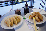 Vienna, Austria. Rochusmarkt. Mandu & Co. Deep fried Mandus with meat (r.) and vegetables.