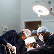 Dr. Professor Outara leads a team of surgeons to perform surgery on Fistula patient. He is 69 years old and a master trainer.