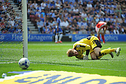Barnsley Goalkeeper Adam Davies watches the shot go wide during the Sky Bet League 1 match between Wigan Athletic and Barnsley at the DW Stadium, Wigan, England on 8 May 2016. Photo by John Marfleet.