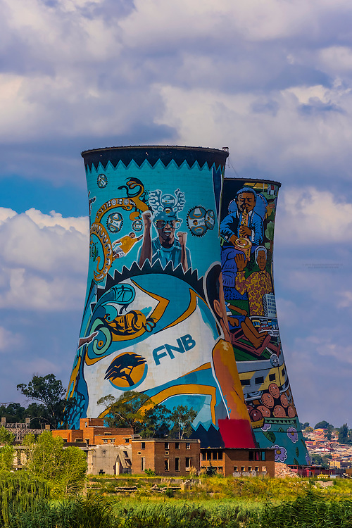 Painted cooling towers (largest mural in South Africa) of decommissioned Orlando Power Station, now a 300 meter bungee jump, Orlando Towers, Soweto, Johannesburg, South Africa.
