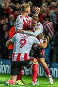 Sunderland Charlie Wyke celebrates his goal with his teammates during the EFL Sky Bet League 1 match between Rochdale and Sunderland at the Crown Oil Arena, Rochdale, England on 20 August 2019.