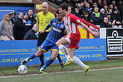 George Francomb of AFC Wimbledon and Sean McConville of Accrington Stanley FC battle during the Sky Bet League 2 match between AFC Wimbledon and Accrington Stanley at the Cherry Red Records Stadium, Kingston, England on 5 March 2016. Photo by Stuart Butcher.