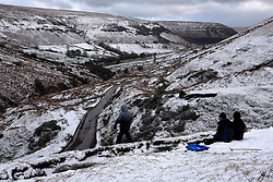 © Licensed to London News Pictures. 29/09/2020. Hay-on-Wye, Powys, Wales, UK. Jason and his two sons Jack  and Caden from Hereford enjoy the snow which suddenly arrived with Storm Jorge this afternoon at Hay Bluff in the Brecon Beacons National Park, in Powys, Wales, UK. Photo credit: Graham M. Lawrence/LNP