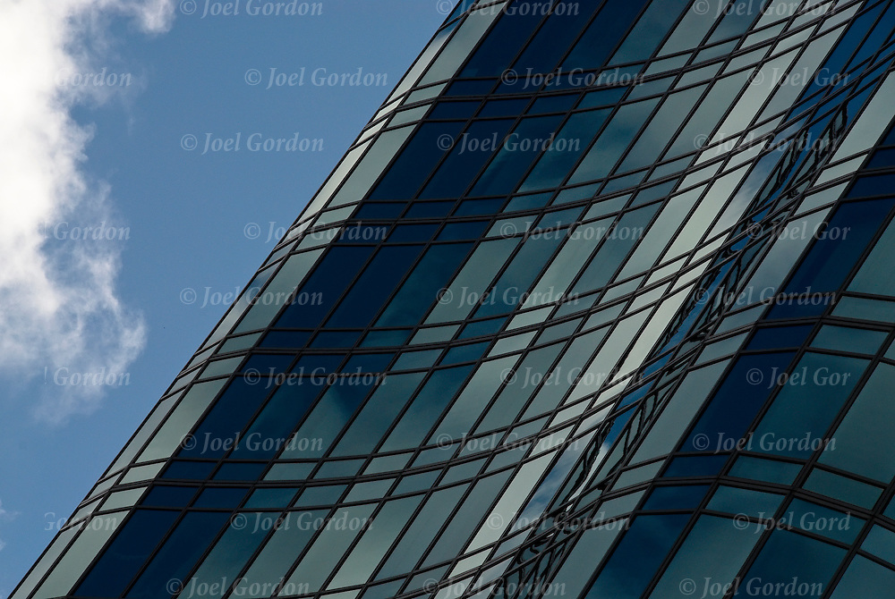 Close up details of reflection of geometric design in windows, patterns, colors, right angles,textures and  shapes