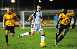 Aaron McGowan of Morecambe is surrounded by David Pipe  and Frank Nouble of Newport County - Mandatory by-line: Nizaam Jones/JMP- 23/01/2018 - FOOTBALL - Rodney Parade - Newport, Wales- Newport County v Morecambe - Sky Bet League Two