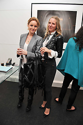 Left to right, RASHA SAID and ALICE NAYLOR-LEYLAND at a private view of an exhibition of photographs by Mike Figgis entitled 'Kate & Other Women' held at The Little Black Gallery, 13 A Park Walk, London SW10 on 22nd June 2011.