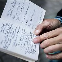 Nederland, Amsterdam, 18 juni 2014.<br /> schrijver Kees van Beijnum en oud rechercheur Kees Hageman.<br /> Kees van Beijnum heeft een boek geschreven over een geruchtmakende moordzaak uit 1989 <br /> in het flatgebouw aan de Banne Buikslootlaan 50 in Amsterdam Noord. (zie foto achtergrond)<br /> Hageman was de rechercheur destijds. <br /> Op de foto: Het aantekeningen boekje van schrijver Kees van Beijnum van de moordzaak destijds<br /> <br /> Foto:Jean-Pierre Jans