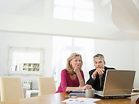 Woman sitting at table with financial advisor