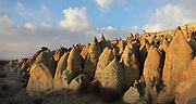 Fairy chimneys in the Devrent Valley, known as Imagination Valley, near Goreme in Nevsehir province, Cappadocia, Central Anatolia, Turkey. The rock formations here were made by erosion of the volcanic tuff created by ash from volcanic eruptions millions of years ago, and many resemble figures or animals, such as camels, snakes, seals and dolphins. This area forms part of the Goreme National Park and the Rock Sites of Cappadocia UNESCO World Heritage Site. Picture by Manuel Cohen
