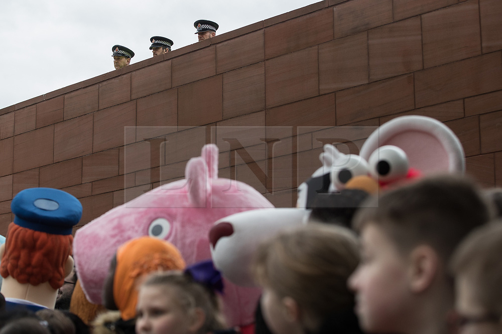 © Licensed to London News Pictures . 06/12/2017 . Manchester , UK . Police watching over . The Duke And Duchess Of Cambridge, Prince William and Kate Middleton, attend the Children's Global Media Summit at the Manchester Central Convention Centre . Photo credit : Joel Goodman/LNP