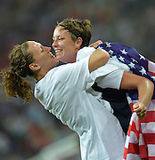 Wembley, Great Britain, USA Striker,  Abby WAMBACH, gets a hug from team mate Hope SOLO [Goalkeeper], as the USA Women's Football Team. grind out  a 2-1 victory, over Japan, to win the Olympic Gold Medal. <br />