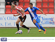 George McLennan and Jai Reason during the Vanarama National League match between Cheltenham Town and Eastleigh at Whaddon Road, Cheltenham, England on 17 October 2015. Photo by Antony Thompson.