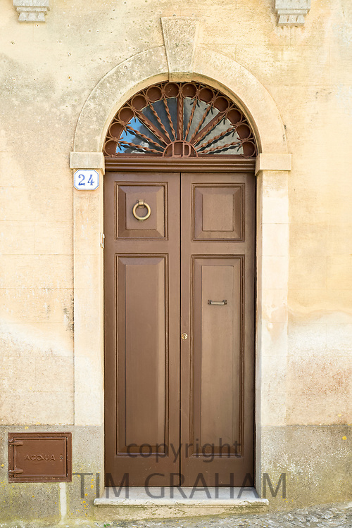 Quaint door and arched doorway in historic centre of Erice, Sicily, Italy
