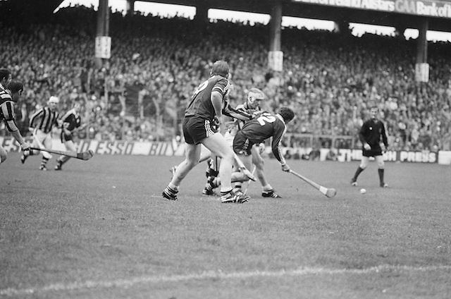 Players challenge for ball during the All Ireland Senior Hurling Final - Kilkenny v Galway, Kilkenny 2-12, Galway 1-8, 2nd September 1979. Black and White, Black and White Photography, Black and White Prints, Photography, Photography Print, Print, Irish Gifts, Irish People, Historical Photos, Irish Society, Irish History, Irish Culture, Images of Ireland, Eire, Film Photography, Old Photos, Vintage Photos, Republic of Ireland, Old Print, Irish Pictures, Irish Images, Sepia, Ireland,