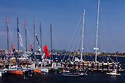 Spectators and Volvo Ocean Race boats at Fan Pier.